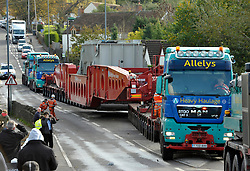 © Licensed to London News Pictures.  03/11/2013.  Wick, South Gloucestershire.  An electricity transformer, one of the biggest abnormal loads ever transported on the roads is driven through the village of Wick, to avoid a weak point in the M4. The giant transformer came from the decommissioned Didcot power station and is being taken to Avonmouth to be shipped abroad.  The load together with the huge transporter, weighed 640 tonnes.  03 November  2013.<br /> Photo credit : Simon Chapman/LNP