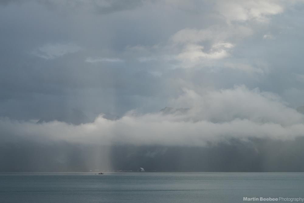 Fishing boat in a lone sunbeam on Resurrection Bay, Seward, Alaska