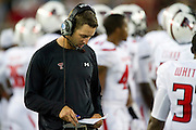 DALLAS, TX - AUGUST 30: Head coach Kliff Kingsbury of the Texas Tech Red Raiders looks at his play sheet against the SMU Mustangs on August 30, 2013 at Gerald J. Ford Stadium in Dallas, Texas.  (Photo by Cooper Neill/Getty Images) *** Local Caption *** Kliff Kingsbury