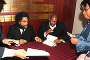 """April 18, 2012- New York, NY : (L-R) Dr. Cornel West and Tavis Smiley sign copies of new book at the Tavis Smiley and Cornel West Talk and Booksigning of their co-authored new book ' The Rich & the Rest of Us: A Poverty Manifesto ' presented by Dr. Brenda Greene and the National Black Writers Conference held at the Slyvia and Danny Kaye Playhouse at Hunter College (CUNY) on April 20, 2012 in New York City. ..The latest census data shows nearly one in two Americans, or 150 million people, have fallen into poverty  or could be classified as low income. Dr. Cornel West and Tavis Smiley, who continue their efforts to spark a national dialog on the poverty crisis with the new book, """"The Rich and the Rest of Us: A Poverty Manifesto."""" (Photo by Terrence Jennings)."""