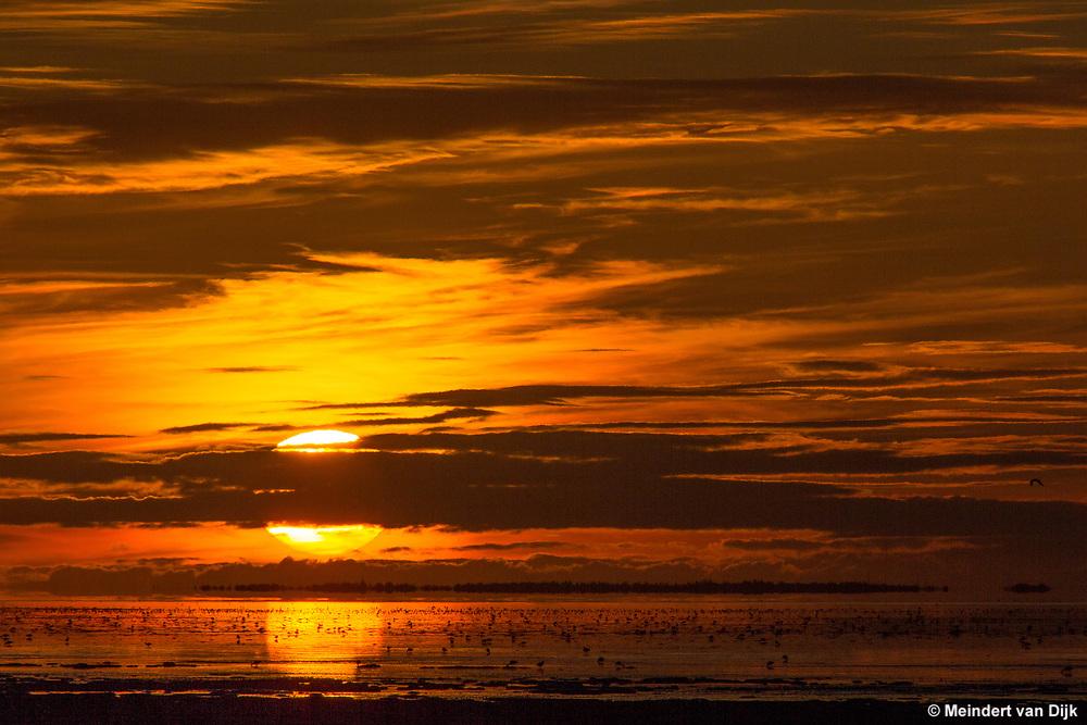 Zonsondergang Waddenzee bij Zwarte Haan