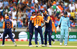 India's Mohammed Shami (centre) celebrates taking the wicket of England's Eoin Morgan (not pictured) during the ICC Cricket World Cup group stage match at Edgbaston, Birmingham.