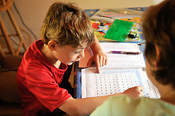 8 year old boy with special needs being home schooled by qualified teacher, UK 2008
