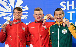 England's James Wilby (silver), Adam Peaty (gold) and South Africa's Cameron van der Burgh (bronze) with their medals after the Men's 100m Breaststroke Final at the Gold Coast Aquatic Centre during day three of the 2018 Commonwealth Games in the Gold Coast, Australia. PRESS ASSOCIATION Photo. Picture date: Saturday April 7, 2018. See PA story COMMONWEALTH Swimming. Photo credit should read: Danny Lawson/PA Wire. RESTRICTIONS: Editorial use only. No commercial use. No video emulation.