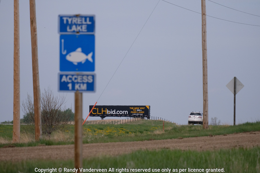 Photo Randy Vanderveen<br /> 2019-05-30,<br /> Lethbridge, Alberta<br /> While the familiar CLH Bid.com advertising is a common sight along roads in the Peace River Country, this sign was spotted along Highway 4 just north of Warner. The Grande Prairie-based company offers another option for farmers and ranchers to buy and sell land.