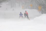 Snowmobiles on country road<br /> Dorset<br /> Ontario<br /> Canada