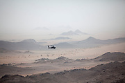 """Mcc0081437 . Daily Telegraph<br /> <br /> DT Foreign<br /> <br /> A Saudi Apache helicopter flies across the border into Yemen on an escort mission <br /> . <br /> Yemen has been in the midst of a civil war since 2015 when the President Abdrabbuh Mansur Hadi was forced to flee . A Saudi led coalition with 9 other Arab states  named """"Operation Decisive Storm """"  has since sought to restore Hadi with little effect .<br /> <br /> Yemen 20 February"""