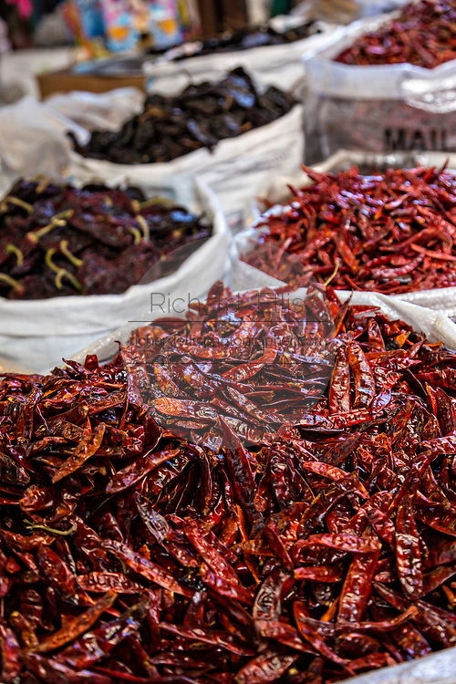 Dried red chili peppers at Benito Juarez market in Oaxaca, Mexico.