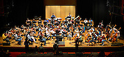 © Licensed to London News Pictures. 28/08/2012. London, UK A photo call for The National Youth Orchestra of Iraq (NYOI) in rehearsal for its London debut at the Queen Elizabeth Hall, Southbank Centre London on Tuesday 28 August. with cellist Julian Lloyd Webber today 28 August 2012. Photo credit : Stephen Simpson/LNP