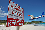 Airport warning sign with airplane taking off from St. Barthelemy airport