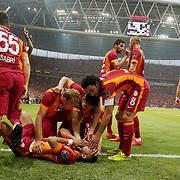 Galatasaray's Yasin Oztekin (F) celebrate his goal with team mate during their Turkish Super League derby match Galatasaray between Besiktas at the AliSamiYen Spor Kompleksi TT Arena at Seyrantepe in Istanbul Turkey on Sunday, 24 May 2015. Photo by Aykut AKICI/TURKPIX