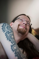Tattooed man relaxing at home