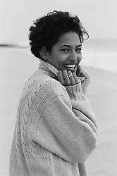Woman on the beach smiling