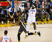 LA Clippers forward Montrezl Harrell (5) fouls Golden State Warriors forward Kevin Durant (35) during a layup attempt at Oracle Arena in Oakland, California, on February 22, 2018. (Stan Olszewski/Special to S.F. Examiner)