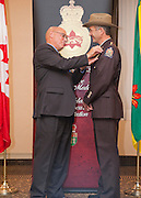 Lieutenant Governor, His Honour the Honourable Dr. Gordon L. Barnhart, S.O.M., presents the Saskatchewan Protective Services Medal. Recipient: Mr. Jim Oliver, Ministry of Environment