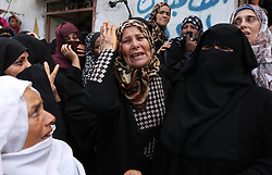 August 17, 2017 - Rafah, Gaza Strip, Palestinian Territory - Palestinian relatives of a security man mourn during his funeral in Rafah, southern Gaza Strip.  (Credit Image: © Ashraf Amra/APA Images via ZUMA Wire)