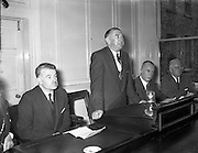 05/10/1954<br /> 10/05/1954<br /> 05 October 1954 <br /> Dublin Chamber of Commerce announcement of the new National loan at Dublin Chamber of Commerce, Dame Street, Dublin. Minister for Finance Gerard Sweetman T.D. seated on left.