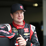 Driver Kurt Busch is seen near the garage area during the 56th Annual NASCAR Daytona 500 practice session at Daytona International Speedway on Saturday, February 22, 2014 in Daytona Beach, Florida.  (AP Photo/Alex Menendez)