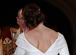 Princess Eugenie, with the scar from her surgery for scoliosis to treat a curvature of the spine at the age of 12 visible, as she enters St George's Chapel for her wedding to Jack Brooksbank in Windsor Castle, Windsor.