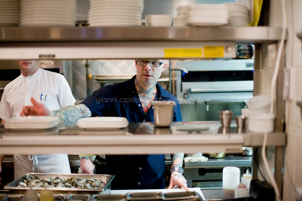 """15 December, 2008. New York, NY. Ed Witt at Bloomingdale Road is """"on stage"""" for a small birthday party of five people in the open kitchen of Bloomingdale Road's dining room, a New York restaurant. Several restaurants offer special seatings with their celebrity chefs.<br /> <br /> ©2008 Gianni Cipriano for The New York Times<br /> cell. +1 646 465 2168 (USA)<br /> cell. +1 328 567 7923 (Italy)<br /> gianni@giannicipriano.com<br /> www.giannicipriano.com"""