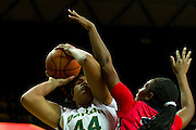 WACO, TX - DECEMBER 18: Kristina Higgins #44 of the Baylor Bears drives to the basket against Danielle McCray #22 of the Mississippi Lady Rebels on December 18 at the Ferrell Center in Waco, Texas.  (Photo by Cooper Neill) *** Local Caption *** Danielle McCray; Kristina Higgins