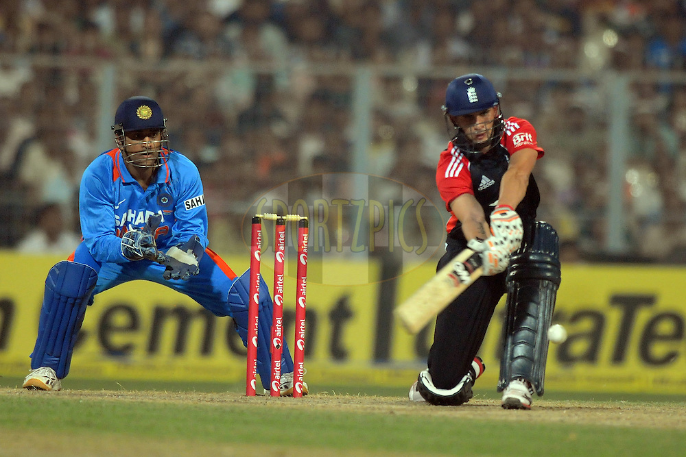 Mahendra Singh Dhoni captain of India  looks on as Ales Hales of England bats during the T20 International match between India and England held at the Eden Gardens Stadium, Kolkata on the 29th October 2011..Photo by Pal Pillai/BCCI/SPORTZPICS