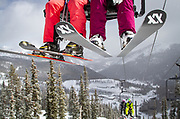 Skiers ride the Garfield chair over a ridge on the way to the top of Monarch Mountain.