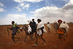 Leyualem, 14, is wisked away on a mule by her new groom and groomsmen in the Amhara Region, Ethiopia on May 23, 2007.  Leyualem had never met her husband before her wedding day, yet sumitted as they bound her in the white wedding cloth. The men later said it was placed over her head so she would not be able to find her way back home, should she want to escape the marriage.