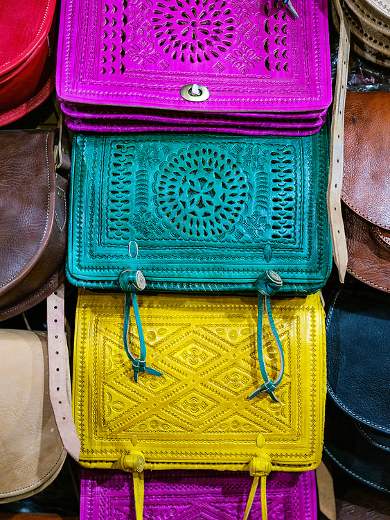 FEZ, MOROCCO - CIRCA MAY 2018: Leather bags and goods for sale at the Chouara Tannery in Fes.  Built in the 11th century, it is the largest tannery in the city. It is located in the Fes el Bali, the oldest medina quarter of the city,