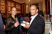 Andrea and Guy Dellal, Silent auction of works by leading artists to celebrate ArtangelÍs 10th birthday. the Old Sierra Leonne Embassy, 33, Portland Place. 7 June 2003. © Copyright Photograph by Dafydd Jones 66 Stockwell Park Rd. London SW9 0DA Tel 020 7733 0108 www.dafjones.com