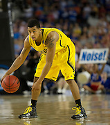 Trey Burke (3) of the University of Michigan Wolverines brings the ball up the court against the University of Kansas Jayhawks during the NCAA South Regionals at Cowboys Stadium in Arlington on Friday, March 29, 2013. (Cooper Neill/The Dallas Morning News)