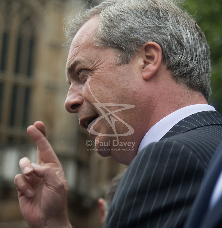 """Smith Square, Westminster, London, June 16th 2016. UKIP leader Nigel Farage launches his """"biggest ever"""" advertising campaign as Leave and Remain enter their last week of campaigning before the EU referendum on June 23rd. PICTURED: Fingers crossed! Nigel Farage gestures to a member of the public."""