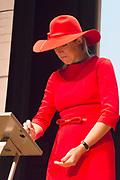 Koningin Maxima bij symposium 40 jaar Blijf van m'n Lijf in het Tropenmuseum, Amsterdam.Het symposium geeft inzicht in de geschiedenis van de vrouwenopvang en de nieuwe mogelijkheden voor de aanpak van huiselijk geweld. <br /> <br /> Queen Maxima Symposium Stay 40 years of my Body in the Tropenmuseum, Amsterdam.The symposium provides insight into the history of the women's and the new possibilities for addressing domestic violence.<br /> <br /> op de foto / On the photo:  Koningin Maxima,tijdens de lancering van de app Ican, die vrouwen na een situatie met partnergeweld helpt herstellen en bouwen aan zelfvertrouwen.<br /> <br /> Queen Maxima,during the launch of the app Ican that women after a situation of domestic violence helps repair and build self-confidence.