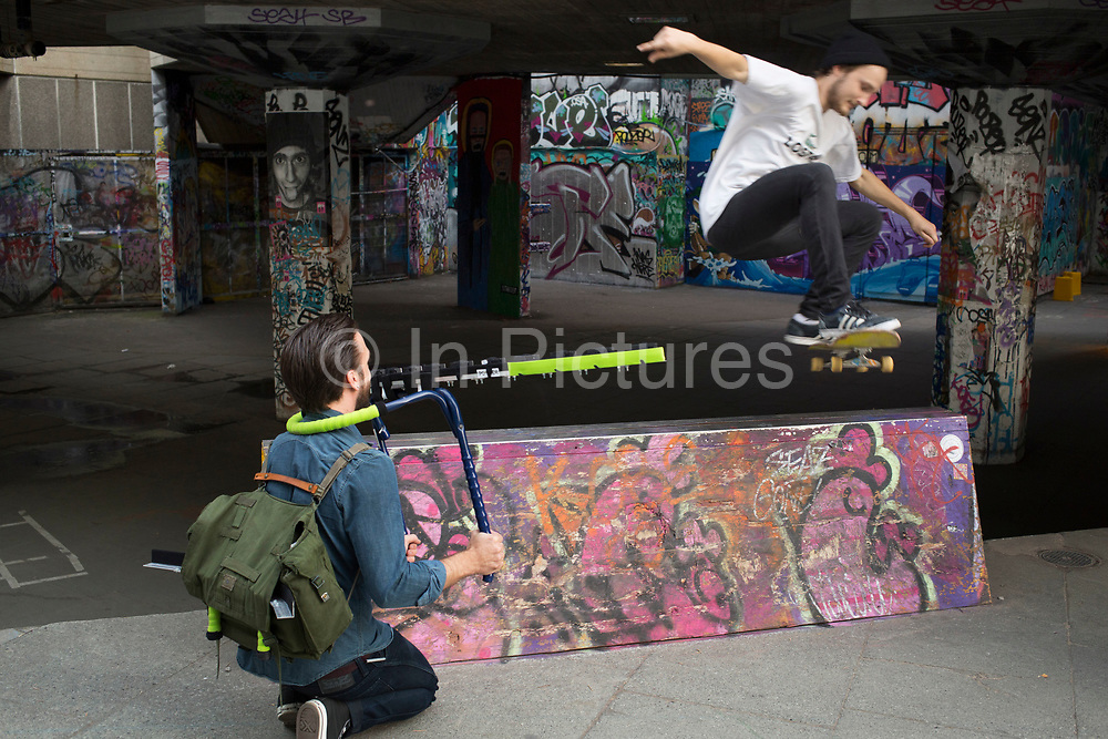 Skateboarder being filmed with a special 3D camera. The undercroft of the foyer building of the Queen Elizabeth Hall on the South Bank has been popular with skateboarders since the early 70's and it is widely acknowledged to be London's most distinctive and popular skateboarding area. The area is used by skateboarders, BMXers, graffiti artists, taggers, photographers, buskers, and performance artists, among others.