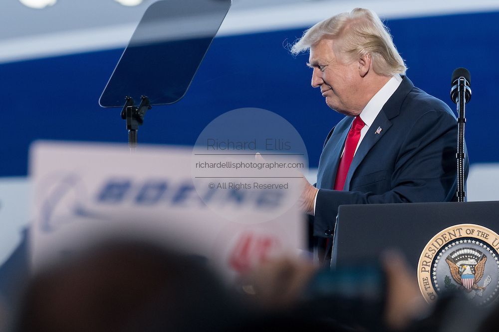 U.S. President Donald Trump walks off stage after addresses employees at the debut of the new Boeing 787-10 Dreamliner aircraft at the Boeing factory February 17, 2016 in North Charleston, SC. The visit comes two days after workers at the South Carolina plant voted to reject union representation in a state where Trump won handily.