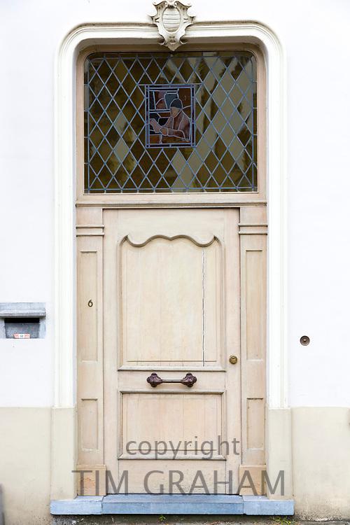 Traditional wooden door and doorway with leaded light windows in old town Bruges - Brugge - Belgium