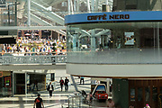 Circular Cafe Nero, once the revolving Godiva Cafe in the Lower Precinct Shopping Centre in the UK City of Culture 2021 on 23rd June 2021 in Coventry, United Kingdom. Coventrys Lower Precinct is a glass-covered shopping area and part of the post-war city centre pedestrianised zone. The area has seen a great deal of development in recent years with the addition of a glass roof and modernisation. The UK City of Culture is a designation given to a city in the United Kingdom for a period of one year. The aim of the initiative, which is administered by the Department for Digital, Culture, Media and Sport. Coventry is a city which is under a large scale and current regeneration.