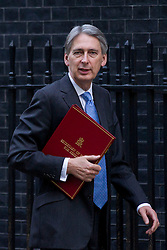 © Licensed to London News Pictures. 26/11/2013. London, UK. The Defence Secretary, Philip Hammond, arrives for a meeting of British Prime Minister David Cameron's Cabinet on Downing Street in London today (26/11/2013). Photo credit: Matt Cetti-Roberts/LNP