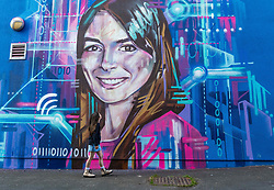 Edinburgh Science Festival, Edinburgh, Scotland, United Kingdom: <br /> Pictured: Valentina Maia, aged 6 years admires the portrait by graffiti and mural artist Shona Hardie of Natalie Duffield, one of the artworks in a street art trail called 'Women in STEM' which showcases the achievements of nine women who have contributed to the world of Science, Technology, Engineering and Maths (STEM). Natalie Duffield is CEO of InTechnology SmartCitie, a company that provides free WiFi in central Edinburgh. Shona has also painted many of the other portraits in the trail which are displayed in venues across the city. <br /> The 2021 Edinburgh Science Festival runs from 26 June – 11 July.<br /> Sally Anderson   EdinburghElitemedia.co.uk