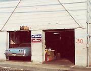 Retro America - 1965 Chevy Impala in mechanics garage. Hackensack, NJ