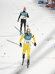 PYEONGCHANG, Feb. 12, 2018  Sweden's Sebastian Samuelsson (front) crosses finishing line during men's 12.5km pursuit event of biathlon at 2018 PyeongChang Winter Olympic Games at Alpensia Biathlon Centre, Feb. 12, 2018. Sebastian Samuelsson claimed second place in a time of 33:03.7. (Credit Image: © Wang Haofei/Xinhua via ZUMA Wire)