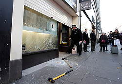 © Licensed to London News Pictures. 20/12/2011. London, United Kingdom .Attempted robbery on a jewellery shop on Oxford Street by persons on two motorbikes..Photo credit : Chris Winter/LNP
