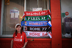 14th October 2017 - Premier League - Liverpool v Manchester United - A Liverpool fan stands below a set of five souvenir scarves relating to their famous five European Cup (UEFA Champions League) triumphs - Photo: Simon Stacpoole / Offside.