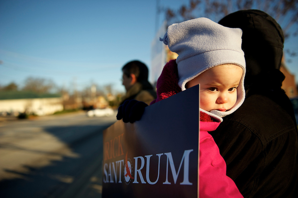 BETHANY KELLY, 2, and mother waive placards in support of Republican Presidential candidate RIck Santorum in advance of a morning town hall at Tommy's Country Ham House.  The South Carolina primary will be held on January 21st.