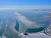 Nederland, Noord-Holland, Gemeente Waterland, 13-02-2021; Marken in de winter, het IJsselmeer (Markermeer) is deels bevroren. In de voorgrond vuurtoren Het Paard, in het verschiet Amsterdam. Kenmerkend voor het winterse weer zijn de verschillende tinten blauw van het bevroren water.<br /> Marken in winter, the IJsselmeer (Markermeer) is partly frozen. In the foreground lighthouse Het Paard.<br /> <br /> luchtfoto (toeslag op standaard tarieven);<br /> aerial photo (additional fee required)<br /> copyright © 2021 foto/photo Siebe Swart
