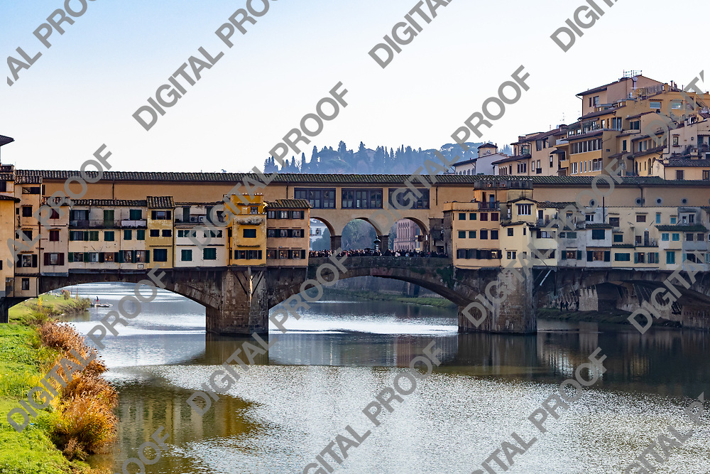 Firenze, Tuscany Italy - December 30, 2018 Ponte Vecchio of Florence viewed from the St Trinity Bridge at day during winter season, tourist crowd at the middle of the Ponte Vecchio