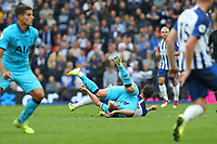 Football - 2019 / 2020 Premier League - Brighton & Hove Albion vs. Tottenham Hotspur<br /> <br /> Lewis Dunk of Brighton gets to grips with Harry Kane of Tottenham off the ball during the Premier League match at The Amex Stadium Brighton  <br /> <br /> COLORSPORT/SHAUN BOGGUST