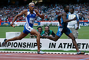 Jerome Young of the United States holds off Marc Raquil of France in the 1,600-meter relay in the IAAF World Championships in Athletics at Stade de France on Sunday, Aug. 31, 2003.
