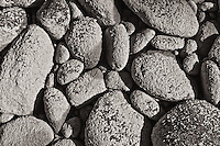 Dried out stones from the bed of the Athabasca River, covered in silt from the glacial runoff. The texture of the silt coating these rocks is very interesting to see up close...©2010, Sean Phillips.http://www.RiverwoodPhotography.com