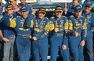 (L-R) Greg Foletta, Cody Crocker, Dean Herridge, Glenn MacNeall at podium.2003 Falken Rally of Queensland.Imbul State Forest, QLD.13th-15th of June 2003 .(C) Joel Strickland Photographics